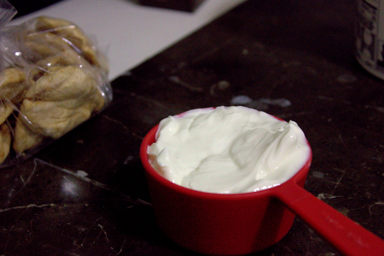 Greek yogurt warming in a cup