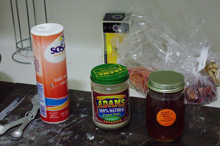 Salt, yeast, and honey standing on the counter