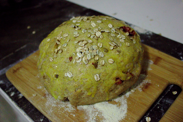 The dough, painted and topped with flakes, ready to bake